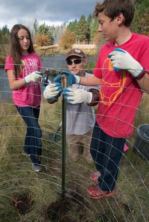 Volunteers help restore Spring Creek. Photo: Jay Mather.