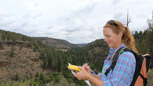 Amanda Egertson does monitoring at Whychus Canyon Preserve. Photo: Land Trust.