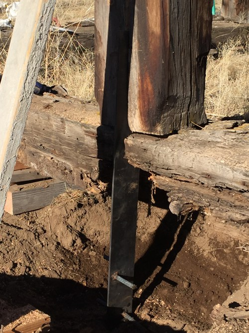 The metal brace slides into the notched post. Photo: Land Trust.