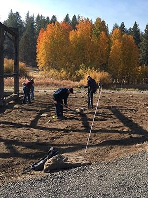 Volunteers help plant around the Hindman barn. Photo: Land Trust.