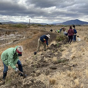 Volunteers help plant a new monarch garden at the Crooked River Wetlands Complex in Prineville. Photo: Land Trust.