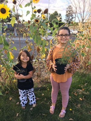 Happy Buff Elementary students with their new milkweed to take home. Photo: Tracey Sklenar.