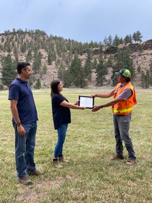 Crestline Construction is presented a certificate to recognize their efforts to fight the Grandview Fire. Photo: Land Trust.