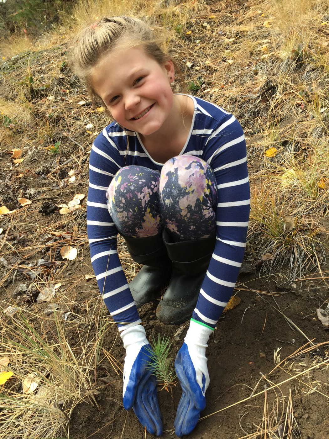 Lucy Egertson planting at Whychus Canyon. Photo: Land Trust