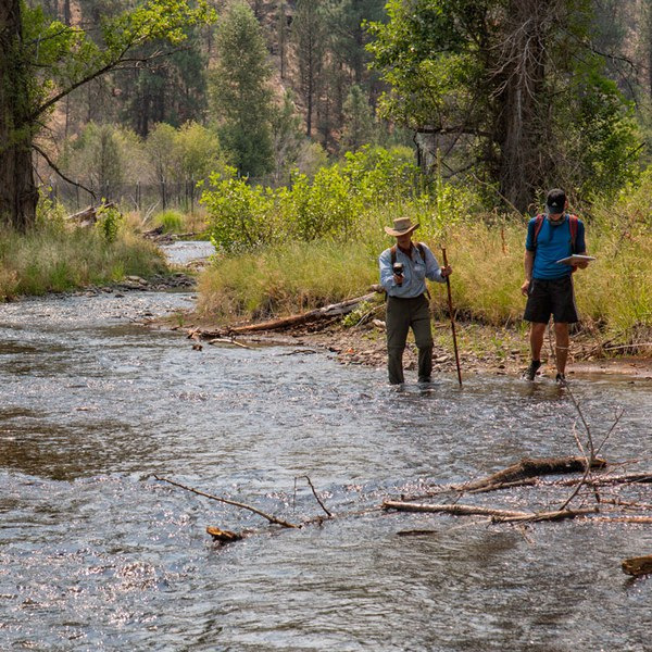 Colin Thorne and a student take temperature measurements of Whychus Creek. Photo: Jay Mather.