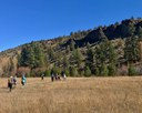 Hikers take in the muted fall colors at Rimrock Ranch. Photo: Joan Amero.
