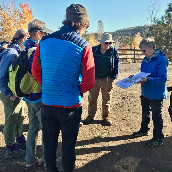 Hikers learn more about the protection of Rimrock Ranch. Photo: Joan Amero.