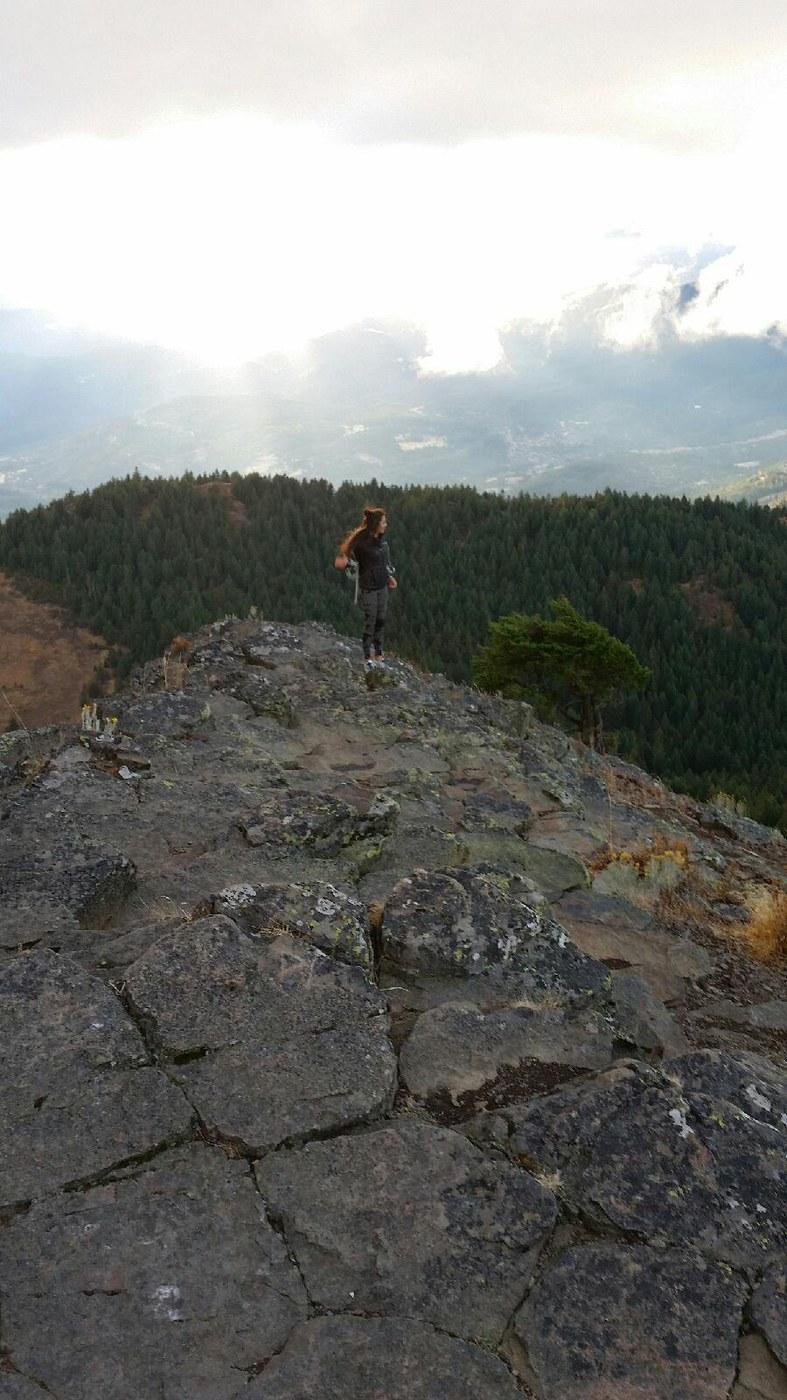 Land Trust Associate, Rebekah Ratcliff, stands atop Pilot Rock near her Ashland, Oregon hometown. Photo: Raquel Valencia