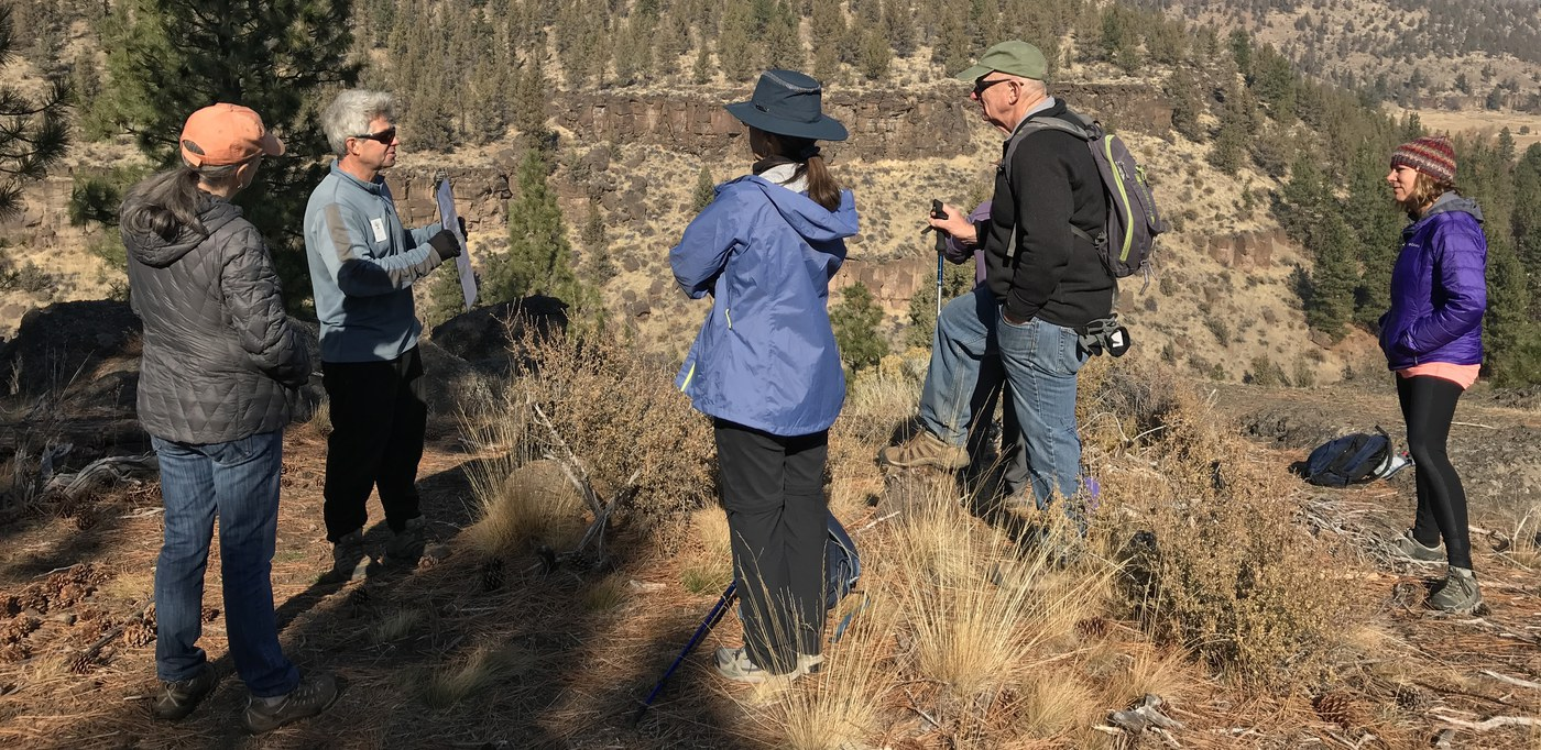 Hikers learn about our local geology as hike leaders point out a fault line. Photo: Joan Amero
