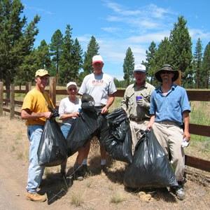 Volunteers pull weeds at Camp Polk Meadow Preserve in 2004. Photo: Land Trust.
