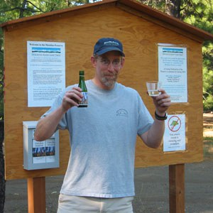 Brad Chalfant celebrates the acquisition of the Metolius Preserve in 2003. Photo: Land Trust.