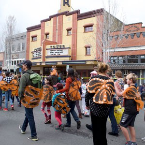 The Land Trust gathers monarch butterflies to march in the Earth Day parade in 2019. Photo: Land Trust.