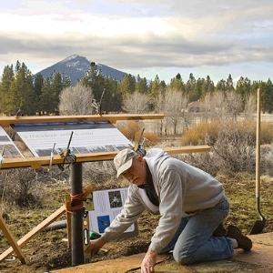 Dick Tipton installing interpretive sign. Photo: Land Trust.
