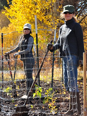 Ashley Lowery and Pamela Burry smile for a photo during a planting. Photo: Land Trust.