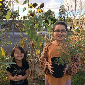 Students at Buff Elementary with their new milkweed plants. Photo: Tracey Sklenar.