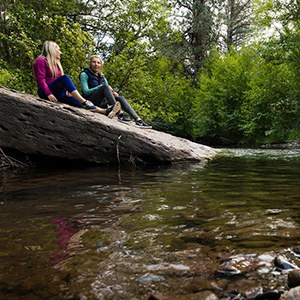 Hikers stop for a break along Whychus Creek. Photo: Tyler Roemer.