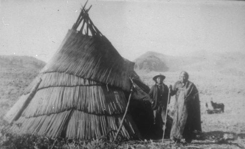 Sahaptin woman and man outside tipi covered with woven tule mats. Photo: Deschutes County Historical Society.