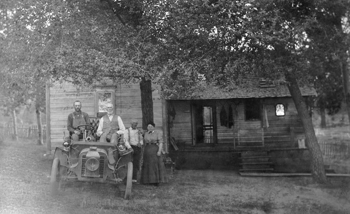 The Hindman home, viewed from the east. Left to right: Gust Olson, Samuel Hindman, Charley Hindman, Martha Taylor Cobb Hindman, and a 1903 Packard car (c. 1918). Photo: courtesy of Jan Hodgers.