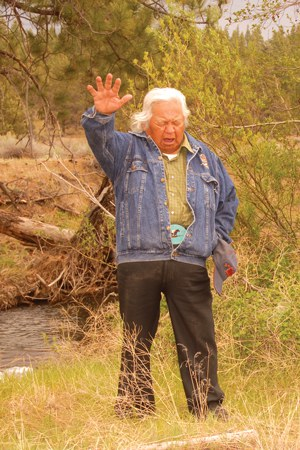 In 2007 at Camp Polk Meadow Preserve, Confederated Tribes of Warm Springs Chief Delvis Heath offered a blessing to celebrate the first steelhead to be released in Whychus Creek in 50 years. Photo: John Hutmacher.